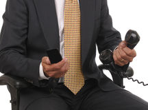 Businessman with cell phone Royalty Free Stock Photo
