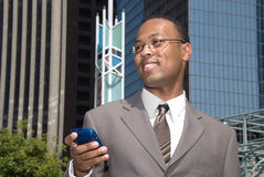 Businessman and cell phone Royalty Free Stock Images