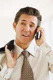 Businessman on cell phone Stock Photos