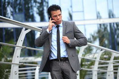 Businessman with Cell Phone Near Business Center Royalty Free Stock Image