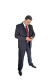 Businessman with cell phone. Royalty Free Stock Images