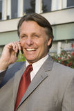 Businessman on cellphone. Stock Images