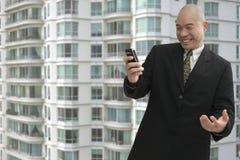 Businessman & cellphone stock photography