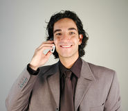 Businessman and cellphone Royalty Free Stock Images