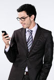 Businessman with cellphone Stock Photos