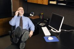 Businessman on cellphone royalty free stock photo