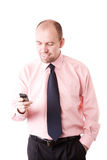 Businessman with cellphone. Isolated on white background, selective focus on face stock image