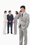Businessman on cellphone with colleagues behind him Royalty Free Stock Photos
