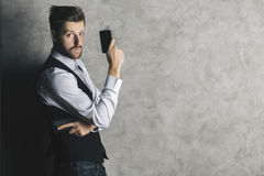 Businessman with cellphone gun Royalty Free Stock Image