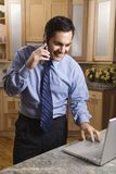 Businessman on cellphone and laptop. Stock Photography