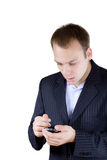 Businessman with a cellphone looking shocked Stock Photography