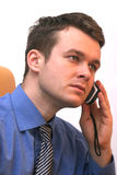 Businessman on cellular phone - active listener. Active listener - handsone young man on cellphone royalty free stock photos