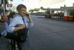 Businessman on cellular phone in Hong Kong Stock Photography
