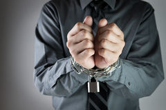 Businessman with chained hand Royalty Free Stock Photography