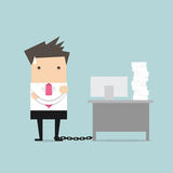 Businessman chained to the desk Royalty Free Stock Photo