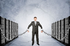 Businessman chained to iron boxes Stock Photos
