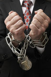 Businessman in chains Stock Images