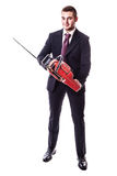 Businessman with chainsaw Stock Photography
