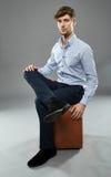 Businessman on a chair portrait Royalty Free Stock Photos