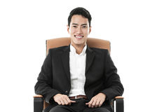 Businessman on a chair Stock Photography
