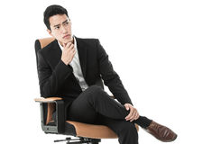 Businessman on a chair Royalty Free Stock Images