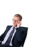 Businessman in chair wearing glasses Royalty Free Stock Photos