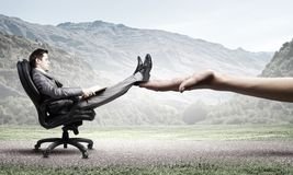 Businessman in chair Stock Images