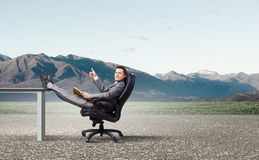 Businessman in chair Stock Photos