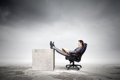 Businessman in chair Stock Image