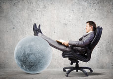 Businessman in chair Royalty Free Stock Image