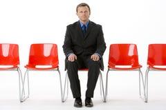 businessman chairs empty row sitting Στοκ Φωτογραφία