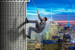The businessman in challenge concept climbing skyscraper Royalty Free Stock Photography