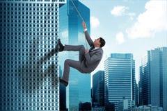 The businessman in challenge concept climbing skyscraper Stock Photo