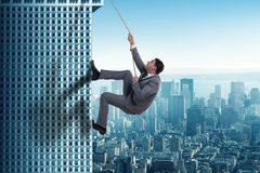 The businessman in challenge concept climbing skyscraper Royalty Free Stock Photos