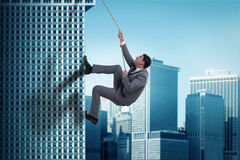 The businessman in challenge concept climbing skyscraper Stock Photography