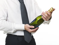 Businessman with champagne bottle Royalty Free Stock Photography