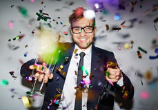 Businessman with champagne Stock Photos