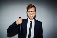 Businessman with champagne Royalty Free Stock Image