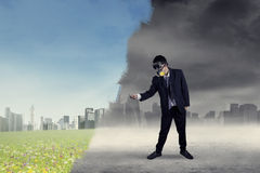 Businessman changes the city Stock Images