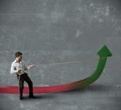 Businessman changes statistics Royalty Free Stock Photo