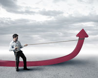 Businessman changes statistics Stock Photos