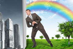 Businessman changing city on nature landscape Stock Images