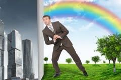 Businessman changing city on nature landscape Stock Images