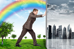 Businessman changing grey city on nature landscape Royalty Free Stock Photo