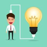 Businessman charging idea from lightbulb. Stock Photos