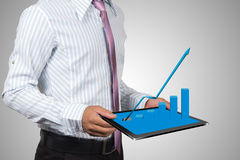 Businessman and chart. Royalty Free Stock Photo