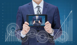 Businessman on chart background growth demonstrates on the mobile device itself. Businessman on chart background growth demonstrates on the mobile device itself Stock Photo