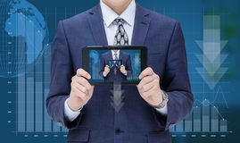 Businessman on chart background loss and shows in the mobile computer itself. Stock Photos