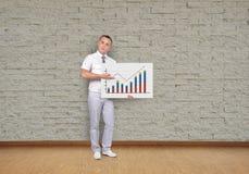 Businessman and chart Stock Photos