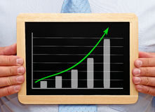 Businessman with chart Royalty Free Stock Images
